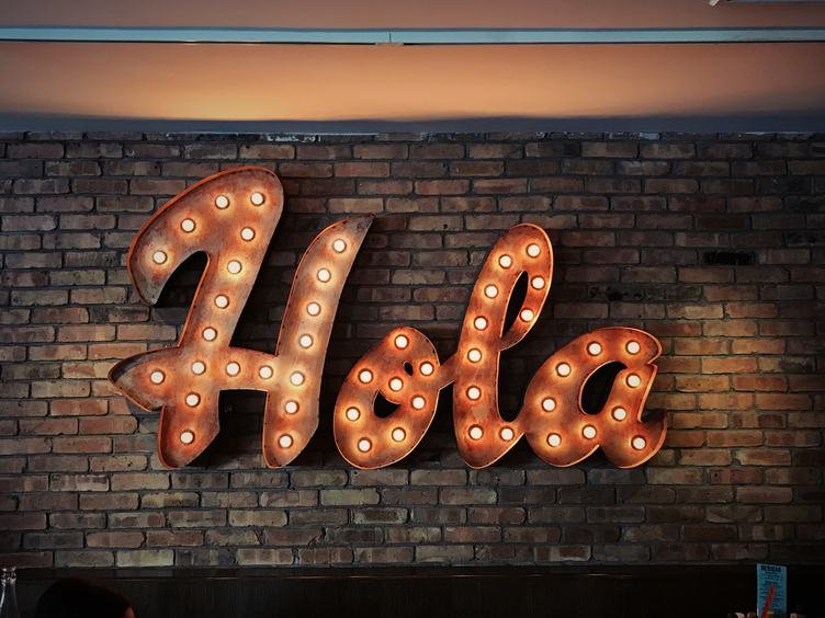 Electric Bulbs Retro Light Frame with Light Text of Hola