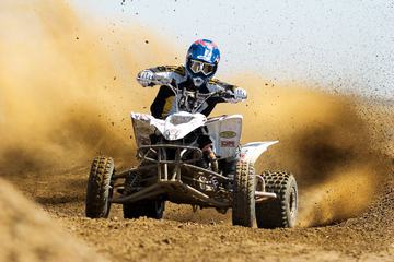 Quad Rider Driving in the Motocross Race