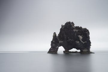 Gray Calm Sea and Island Geology Rock Formation
