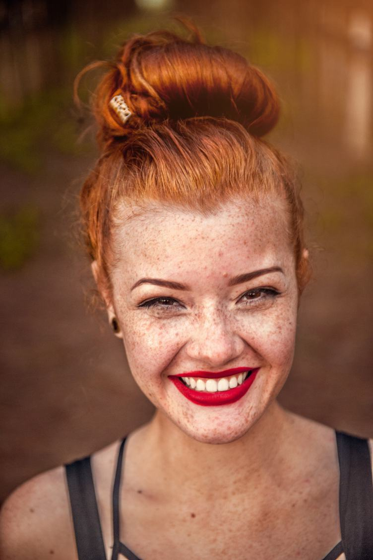 Closeup Portrait of Redhead Girl with Brown Eyes and Freckles, Natural Beauty