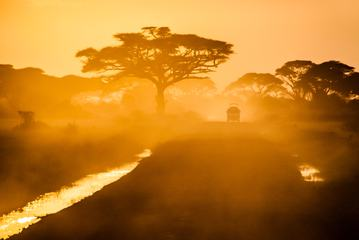 Sunset in African Silhouette of Safari Car