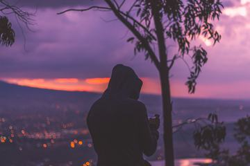 Sunset at the Mountain View with a Man Wearing Hood