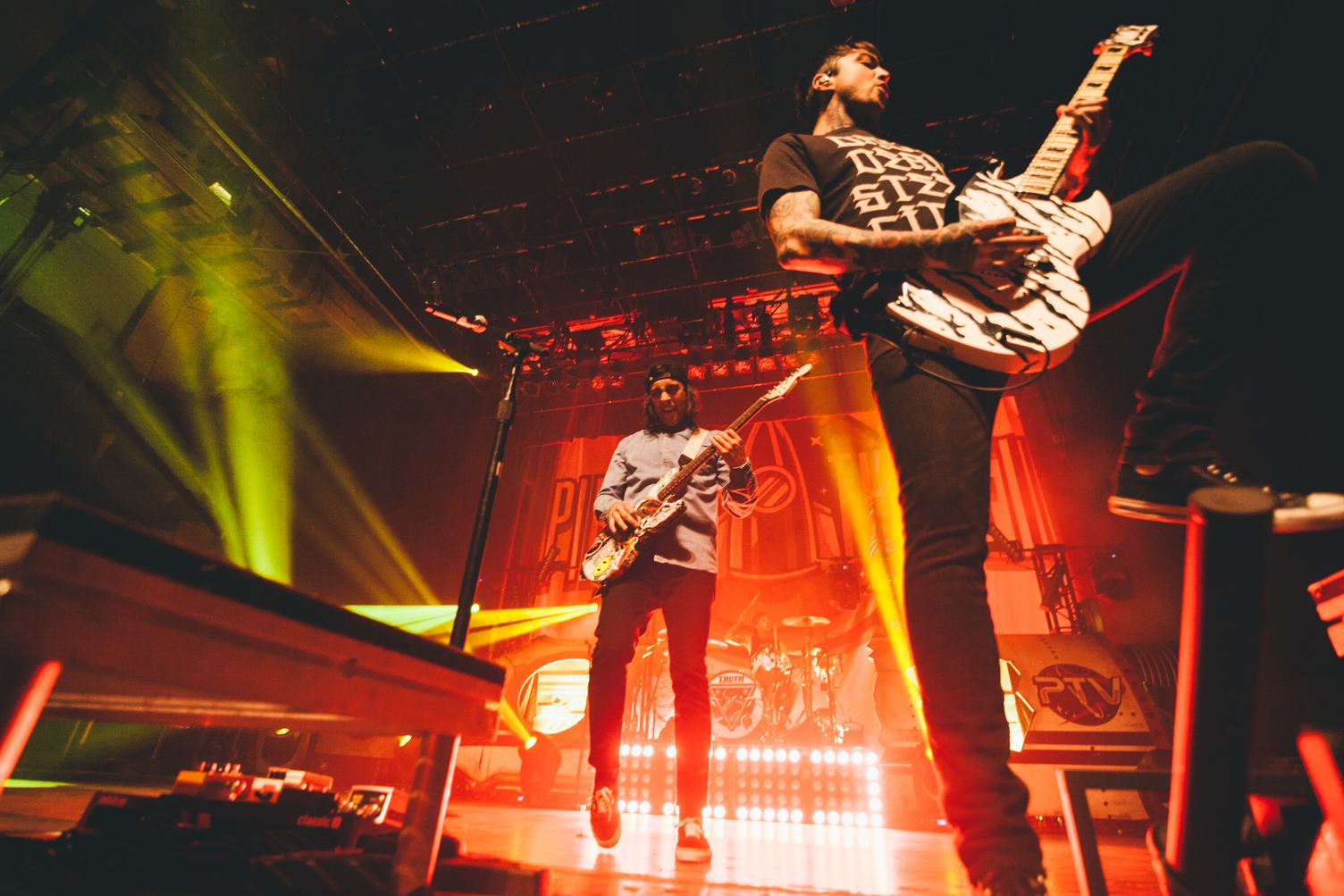 Rock Guitarists Playing Guitar at a Concert