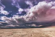 Wilderness over Cloudy Stormy Sky