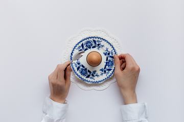 Egg in the Porcelain Stand on White Background