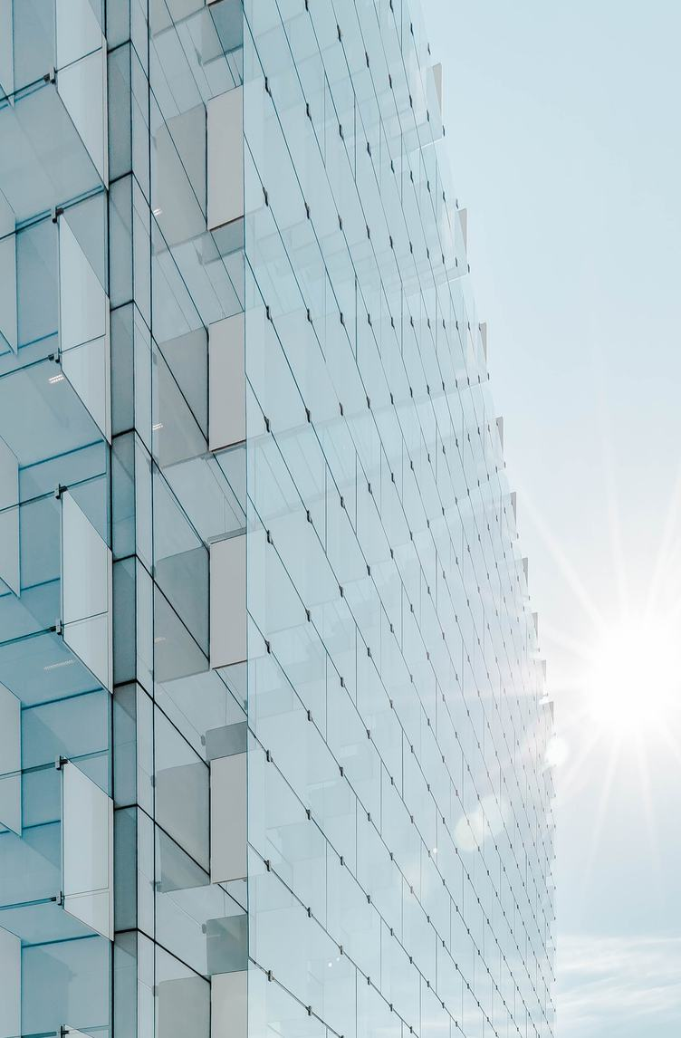 Glass Facade of Modern Office Building with Glare Reflection