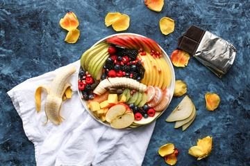 Fruits and Berries in Bowl on Stone Tabletop