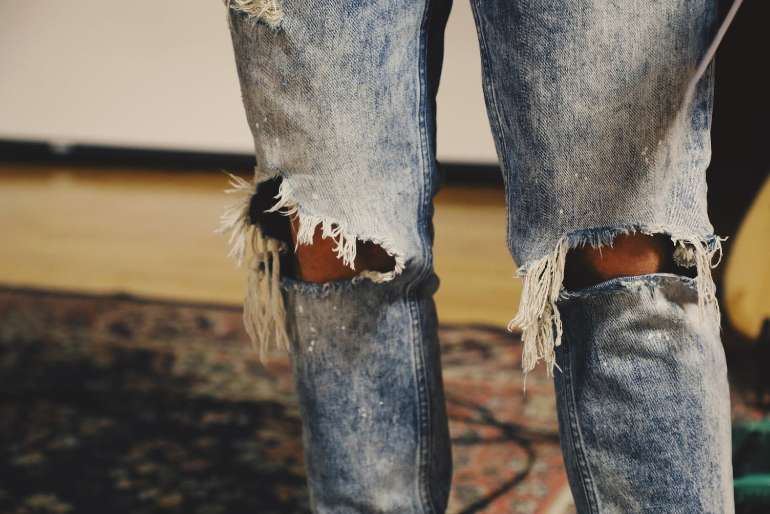 Person in Torn Jeans