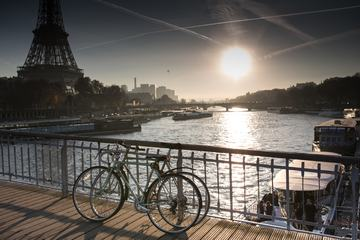 Two Bicycles Standing on the Bridge next to the Eiffel Tower in Paris, France