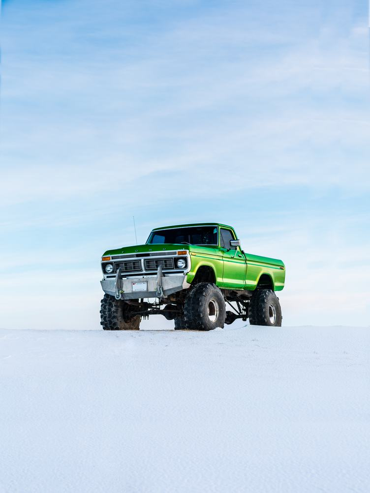 A Large Green Pickup Truck in the Snow