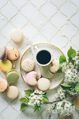 Coffee, Macaroons and Blooming White Branch on a White Table