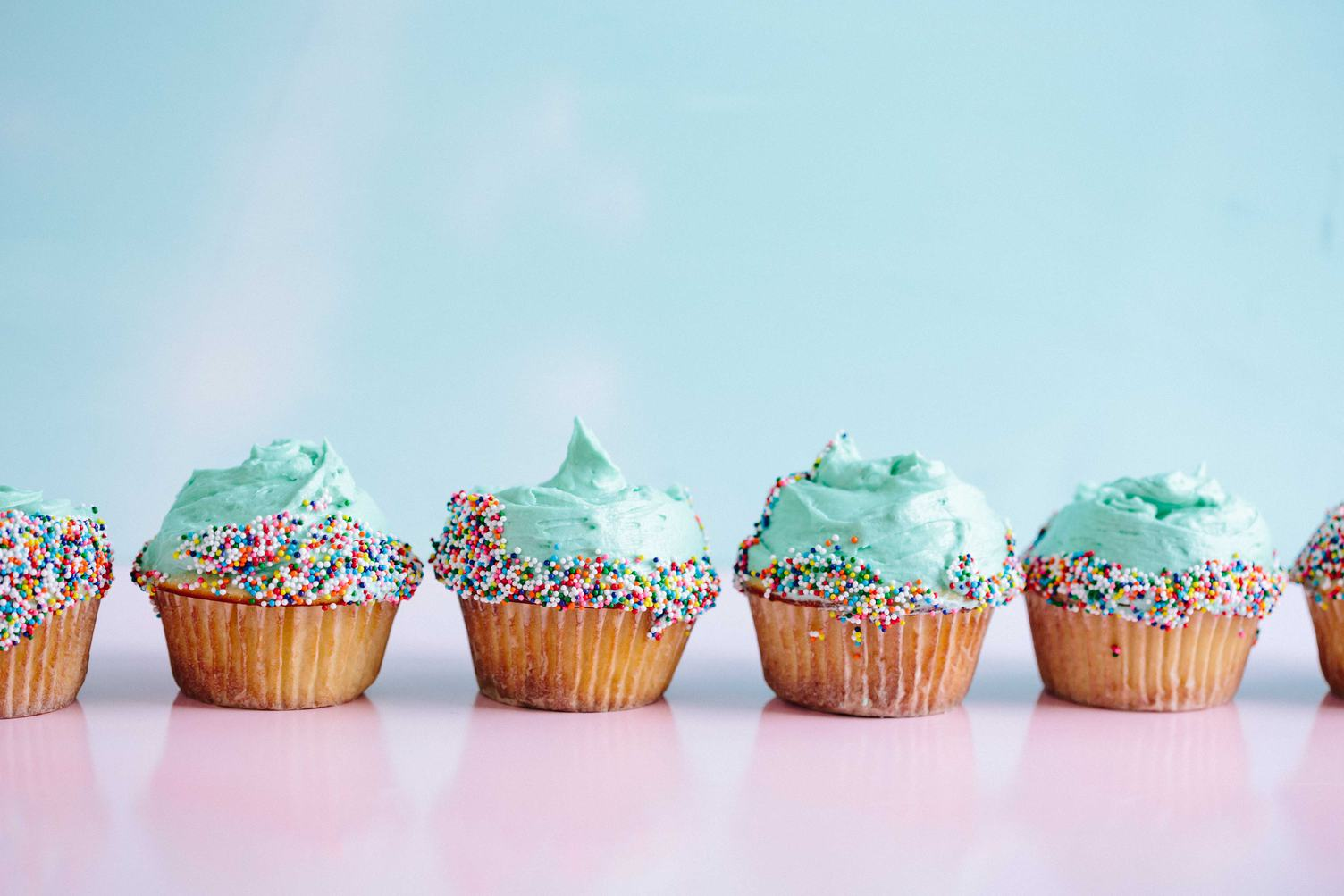 Colorful Cupcakes on a Turquoise Background