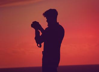 Bearded Man Silhouette Holding Camera