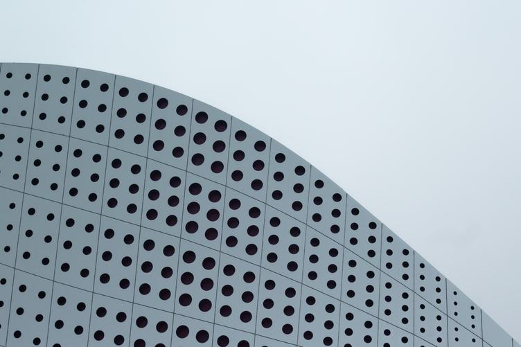 Abstract Facade of Modern Building with Circle Hole