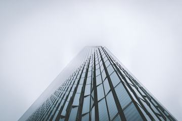 Skyscraper Fading in the Mist