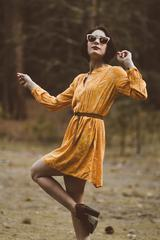Woman in Yellow Retro Dress and High Heels Shoes Dancing in the Forest