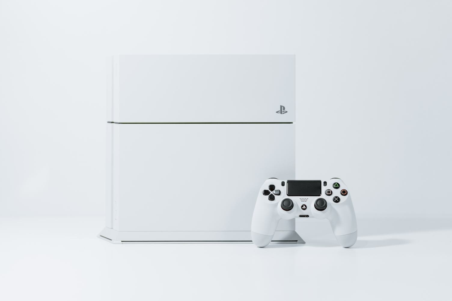 White PS4 Videogame Console and Game Controller
