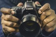Hands Holding the Camera