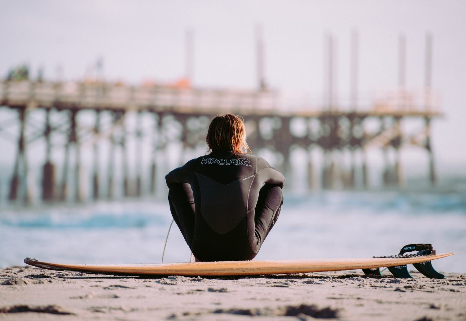 Surfer on the Beach with His Board