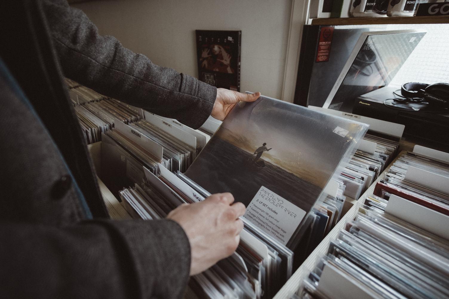 Man Browsing Through Records at a Vinyl Shop