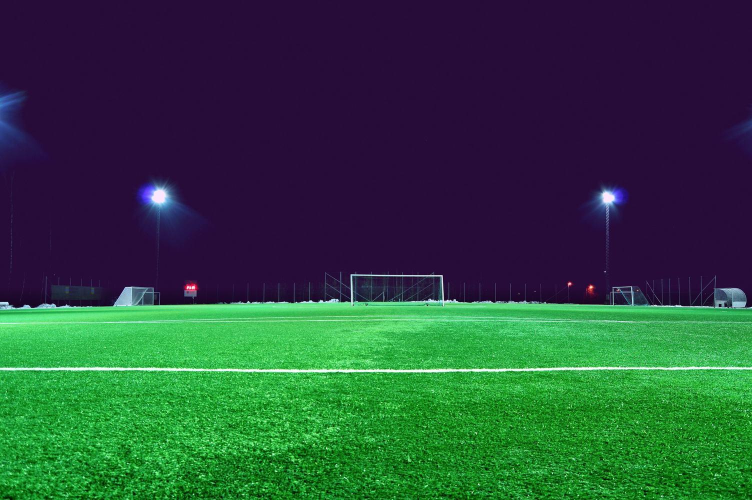 Empty Night Football Field in the Lights