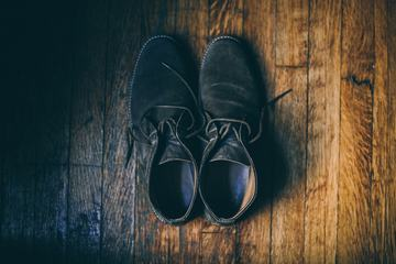 Black Velor Shoes on a Wooden Floor