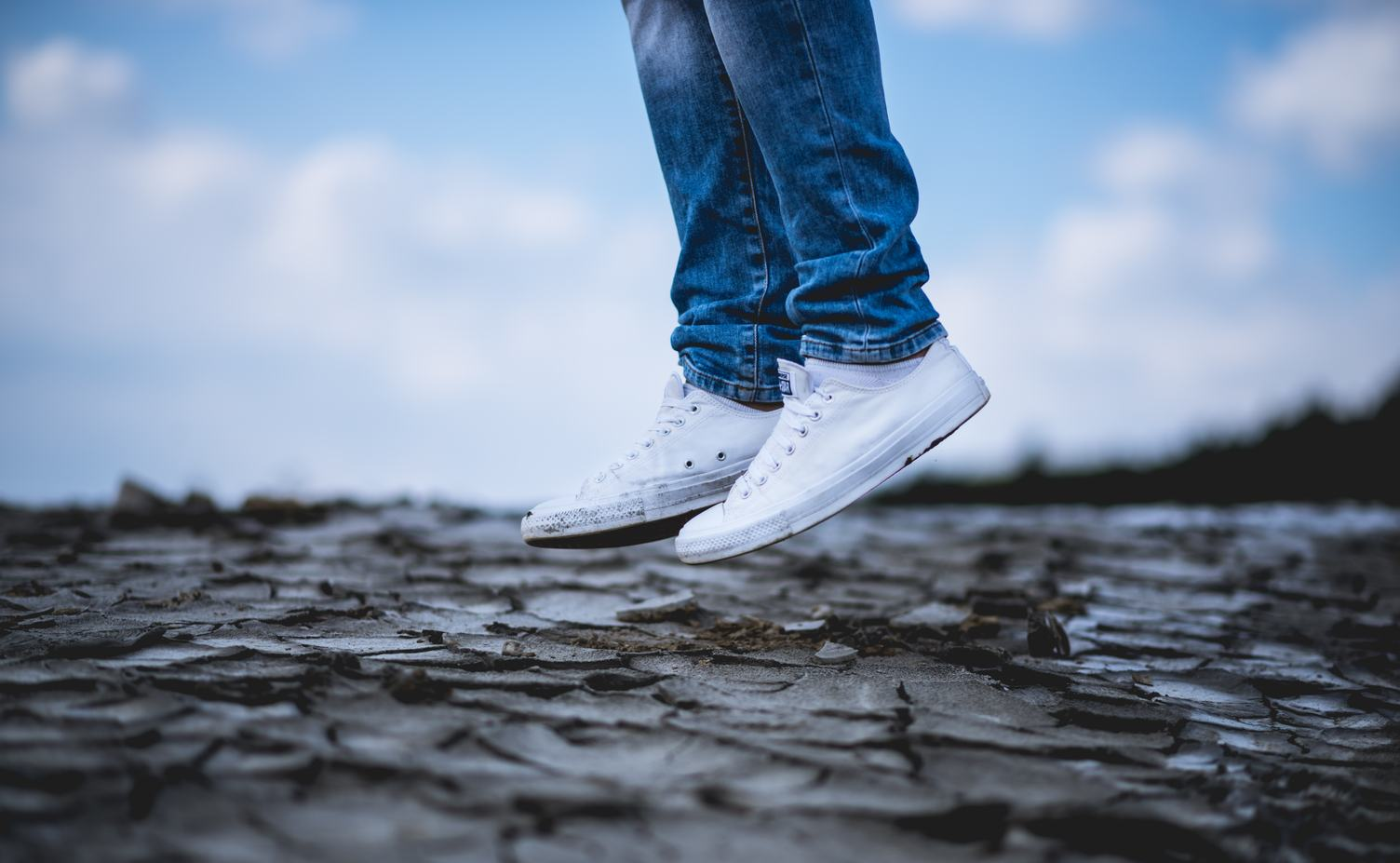 Person in White Sneakers Jumping