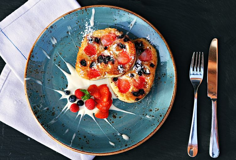 Delicious Dessert Pancakes with Fruits and Cream