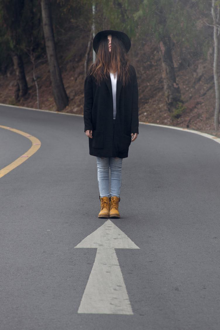Young Girl Standing in the Middle of the Road