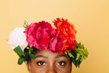 Woman with Flower Wreath on Her Head against Yellow Background