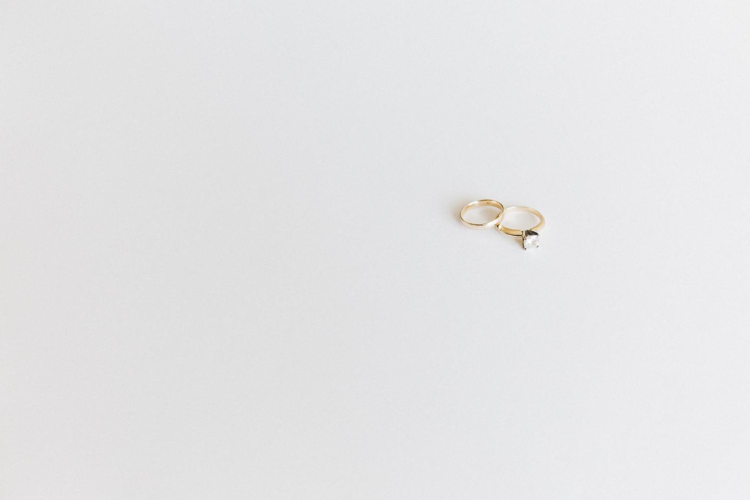 Wedding and Engagement Gold Rings against White Background