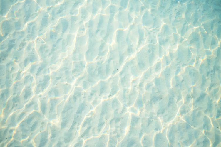 Light Blue Rippled Sand under Water Texture