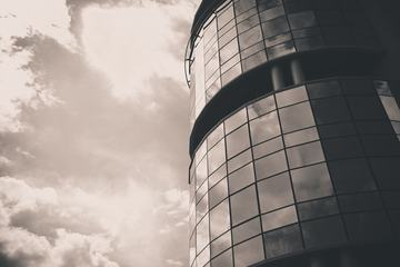 Glass Facade of Office Building Reflecting Clouds