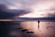 Stunning Long Exposure Sunset Shot Man on the Beach