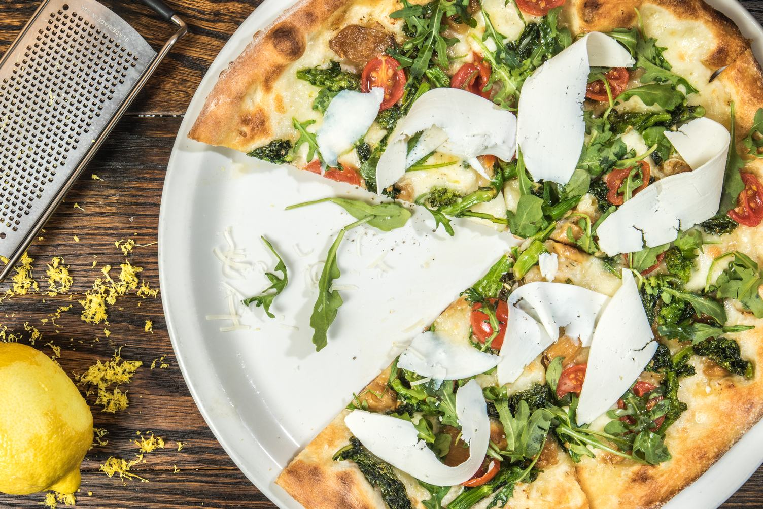 Fresh Baked Pizza with Tomatoes and Rucola