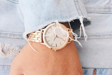Closeup Fashion Details, White and Golden Watch and Jeans