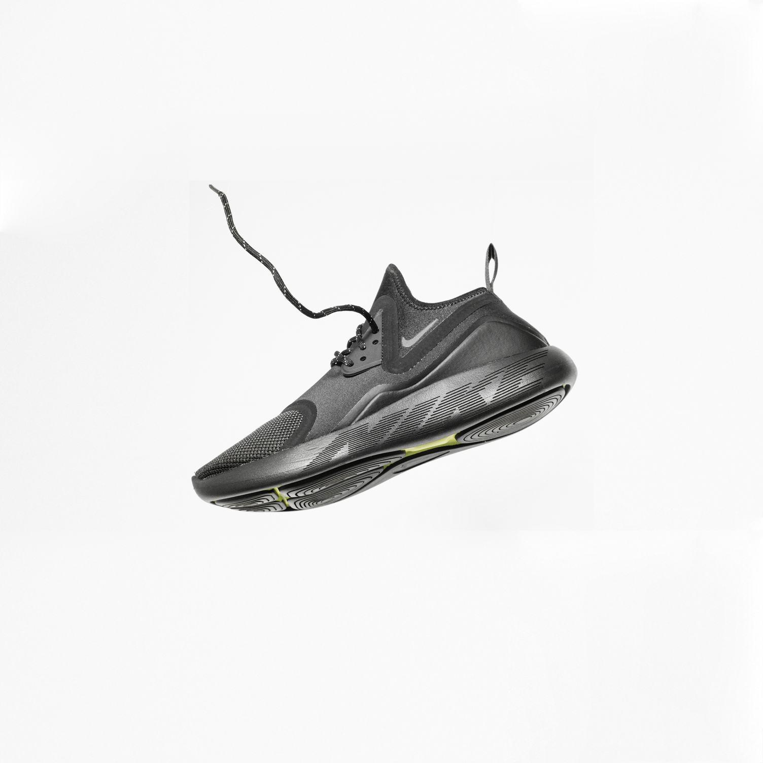 Single Black Nike Sport Shoe Isolated on White Background