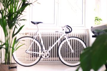 White Bike Lean on the Radiator