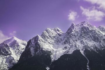 Mountain Peak in Snow against Violet Sky