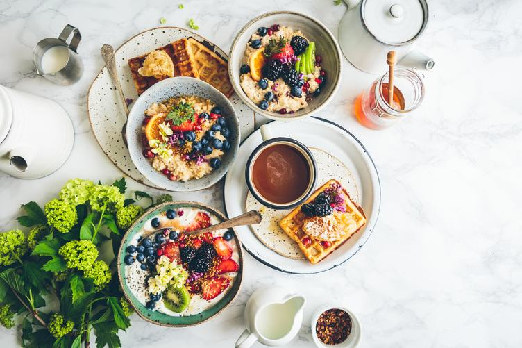 Delicious Breakfast Bowls with Fruits Top View