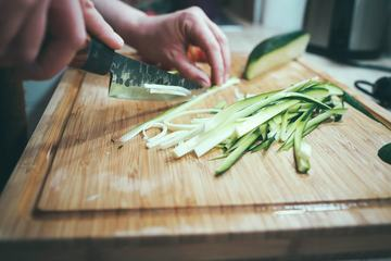 Cut Zucchini in Long Strips on Chopping Board for Cooking
