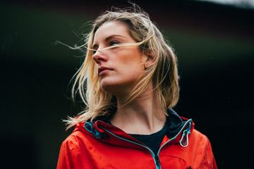 Outdoor Portrait of a Young Lady in a Sports Orange Jacket