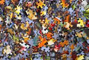 Randomly Scattered Colorful Puzzle Pieces Background
