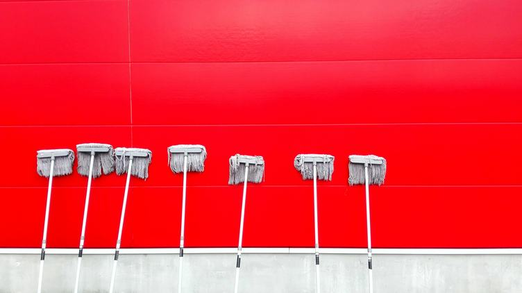 Red Clean Tiled Wall with Seven Mops