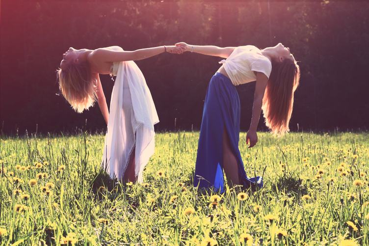 Two Beautiful Young Woman in a Field