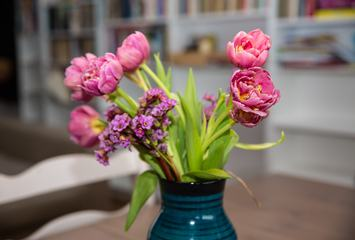 Pink Tulips Bouquet in Vase on Wooden Table