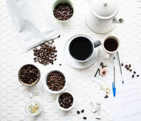 Coffee Beans on Tiled White Table