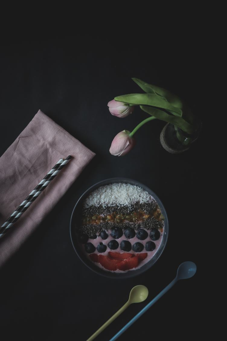 Acai Berry Smoothie Bowl Topped with Chia Seeds, Coconut Flakes, Strawberries and Berries