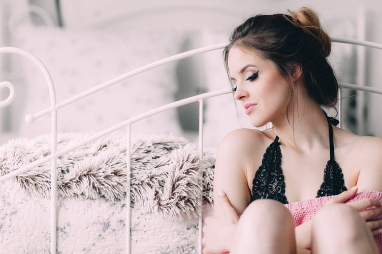 Sensual Portrait of Beautiful Delicate Woman in her Bedroom
