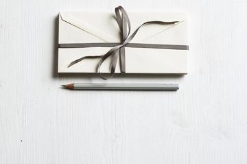 Stacks of Envelopes on a White Wodden Desk